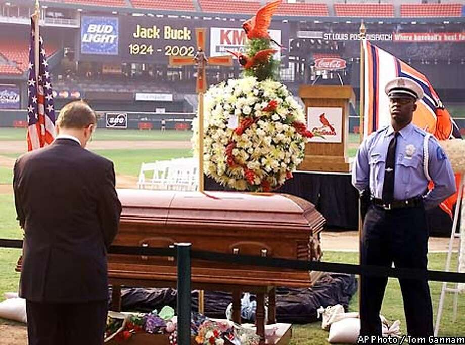 Missouri Gov. Bob Holden pays his respects to the late St. Louis Cardinals hall-of-fame broadcaster Jack Buck Thursday, June 20, 2002 at Busch Stadium in St. Louis. Jack Buck, 77, died late Tuesday night after a long illness. (AP Photo/Tom Gannam) Photo: TOM GANNAM