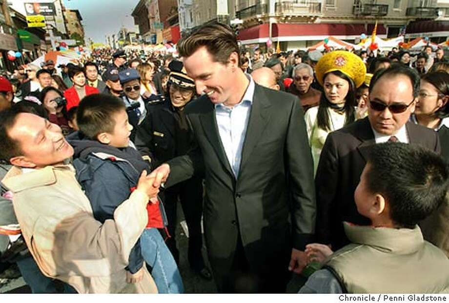 NEWSOMFONG_107_pg.JPG At the Tet Festival, Gavin Newsom walks the street with his new police chief, Heather Fong saying hello to the crowds  Photo taken on 01/18/04 in San Francisco, CA.  Photo By PENNI GLADSTONE / The San Francisco Chronicle Photo: PENNI GLADSTONE