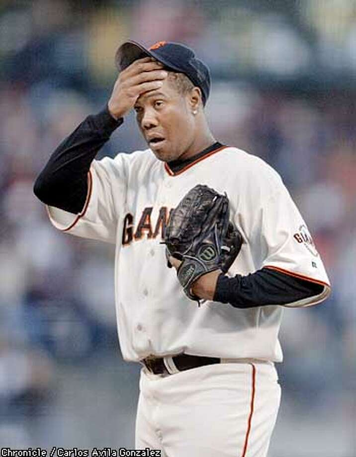 San Francisco Giants pitcher, Livan Hernandez, wipes his forehead after being hit for a two-run home run in the top of the first inning against the Tampa Bay Devil Rays at Pacific Bell Park in San Francisco, Ca., on Tuesday, June 18, 2002. The Devil Rays notched three runs in the inning. (CARLOS AVILA GONZALEZ/SAN FRANCISCO CHRONICLE) Photo: CARLOS AVILA GONZALEZ