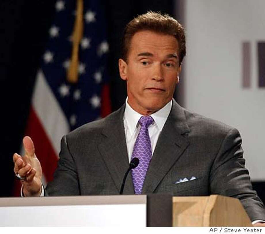Gov. Arnold Schwarzenegger answers a question from a reporter after speaking at the Sacramento Press Club's luncheon in Sacramento, Calif., on Tuesday, Jan. 27, 2004. The Governor talked about a variety of issues before answering questions from the audience.(AP Photo/Steve Yeater) Photo: STEVE YEATER