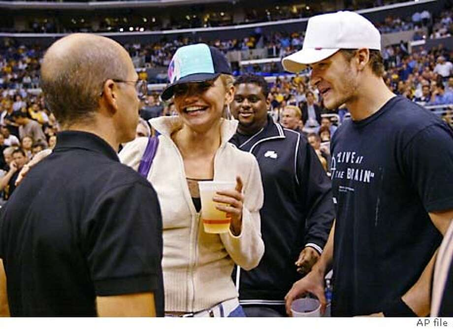 Actress Cameron Diaz, center, is joined by boyfriend Justin Timberlake, left, as she talks with producer Jeffery Katzenberg before the season opener between the Los Angeles Lakers and the Dallas Mavericks in Los Angeles, Tuesday, Oct. 28, 2003. (AP Photo/Kevork Djansezian) Photo: KEVORK DJANSEZIAN