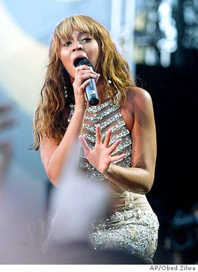 U.S. singer Beyonce Knowles performs at the Nelson Mandela AIDS benefit concert in Cape Town, South Africa Saturday Nov. 29, 2003. (AP Photo/Obed Zilwa) Beyonce has been nominated for six Grammys. Photo: OBED ZILWA