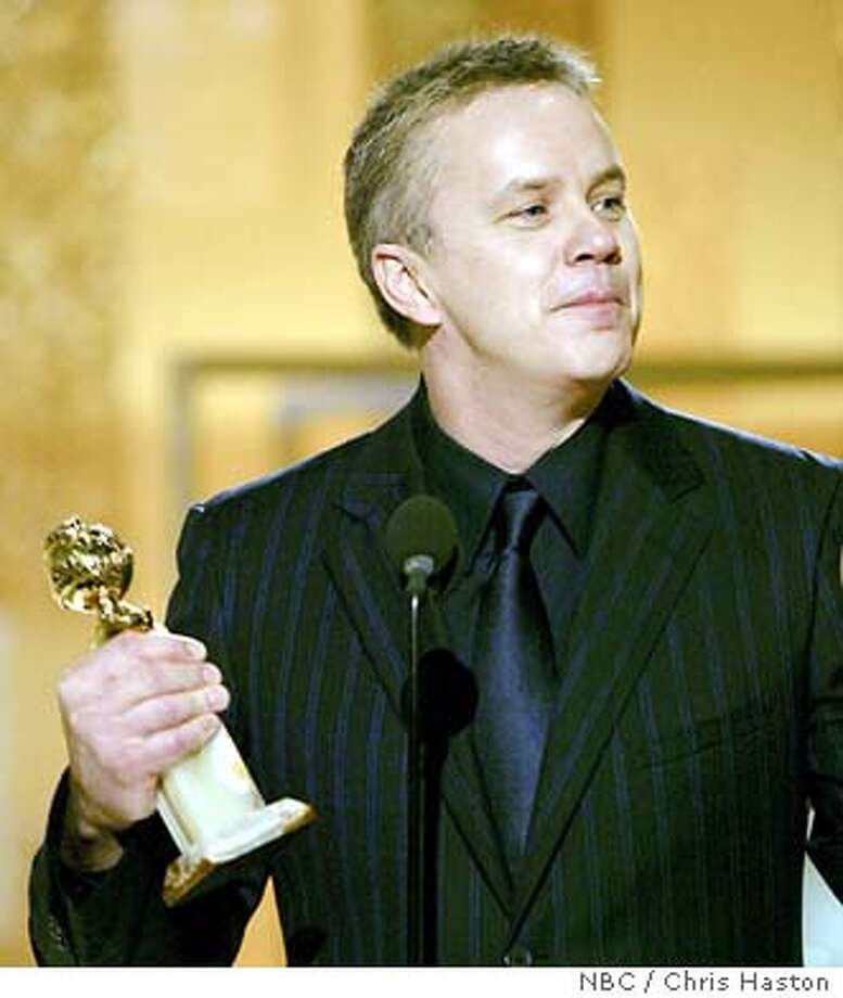 Tim Robbins accepts the award for best supporting actor for his work in �Mystic River,� at the 61st Annual Golden Globe Awards on Sunday, Jan. 25, 2004, in Beverly Hills, Calif. (AP Photo/NBC, Chris Haston) Photo: CHRIS HASTON