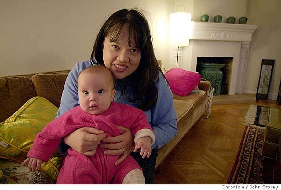 "Author Kim Wong Keltner walks on Ocean Beach at suunset and plays with her baby, Lucy Wong Keltner at her home. She wrote the book ""Dim Sum of All Things"".  1/21/04 in San Francisco. John Storey / The Chronicle Photo: John Storey"