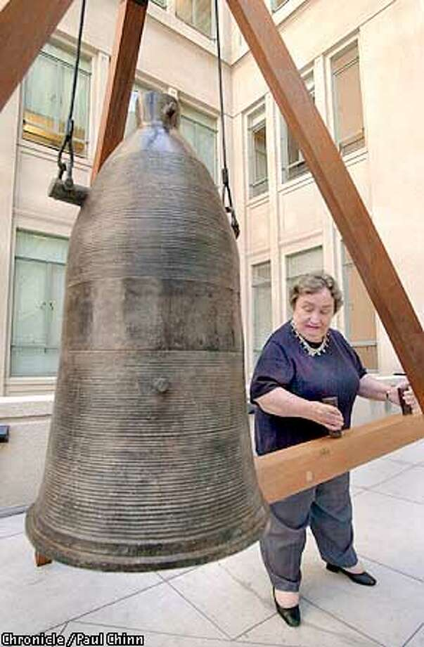 """(UNCORRECTED COLOR IMAGE)  Berkeley mayor Shirley Dean rang a giant """"peace bell"""" which was created from melted-down guns by artist Bruce Hasson. The city is hoping to raise enough money to purchase the bell and place it on permanent display.  PAUL CHINN/S.F. CHRONICLE Photo: PAUL CHINN"""