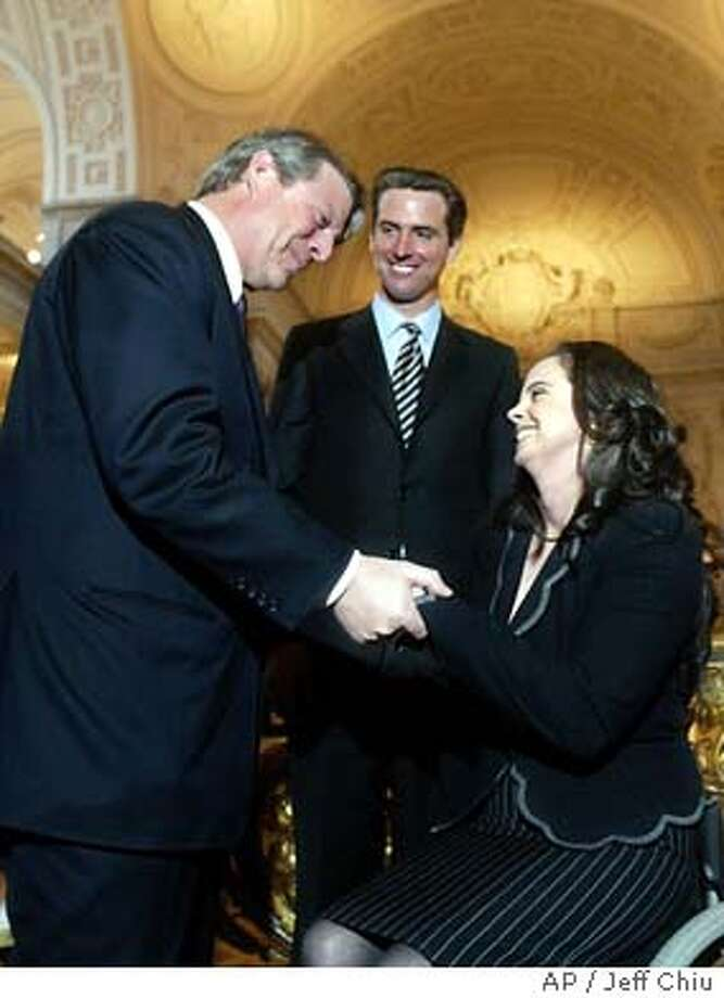 Former vice president Al Gore, left, greets Michela Alioto-Pier as San Francisco Mayor Gavin Newsom, center, watches at City Hall in San Francisco on Monday, Jan. 26, 2004. Alioto-Pier was sworn in as the District Two Member of the San Francisco Board of Supervisors. (AP Photo/Jeff Chiu) Photo: JEFF CHIU