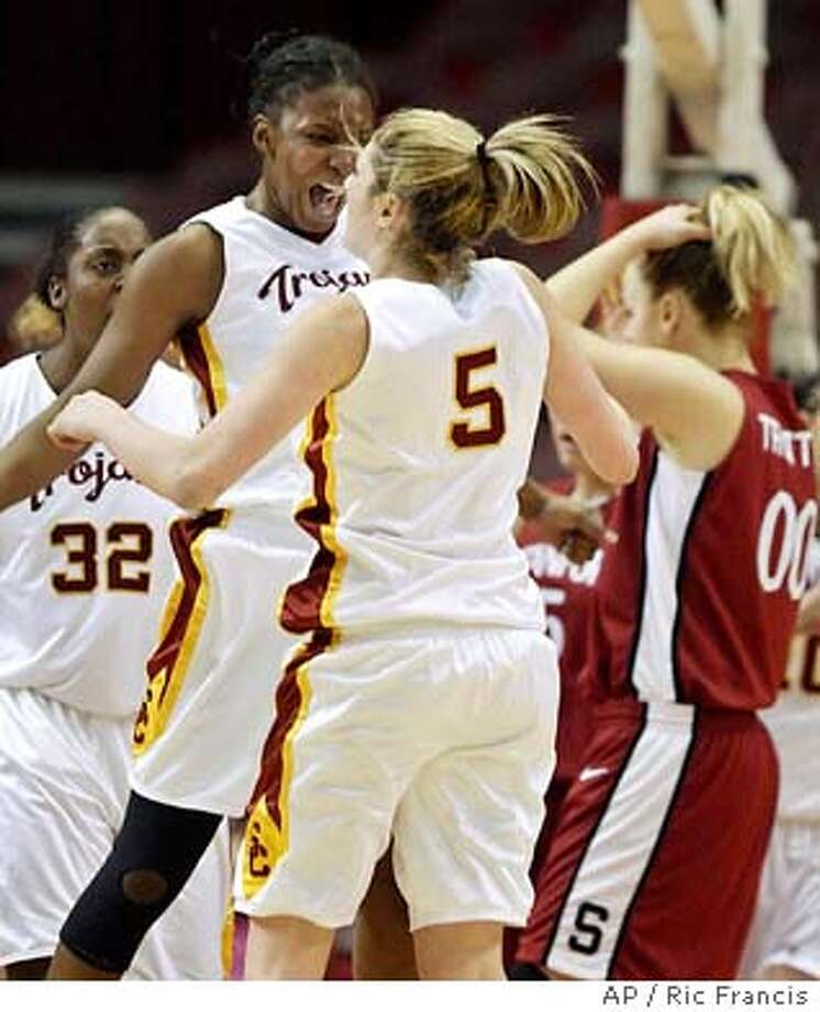 Southern California's Meghan Gnekow (5) is congratulated by Eshaya Murphy, left, as they mount a comeback in the second half against Stanford Sunday, Jan 25, 2004, at the Los Angeles Sports Arena. USC won 59 -56. (AP Photo/Ric Francis) Meghan Gnekow (5) gets a congratulatory bump from teammate Eshaya Murphy during USC's second-half comeback. Photo: RIC FRANCIS