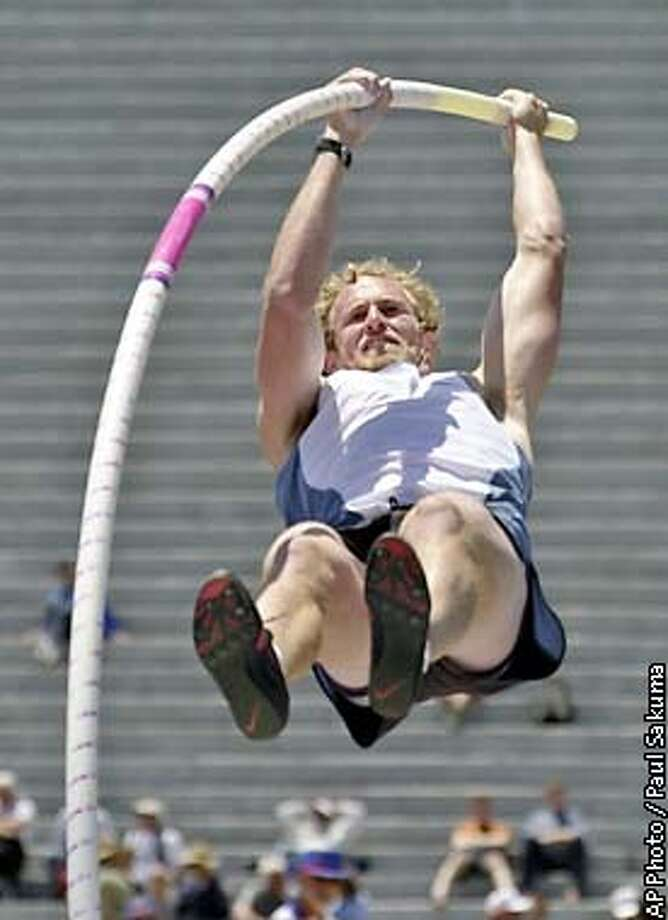 Tom Pappas is about to clear the decathlon pole vault bar at 16 feet 4.75 inches in the U.S. Outdoor Track and Field Championships in Berkeley, Calif., Thursday, June 20, 2002. Pappas tied for third place in the pole vault phase of the decathlon. (AP Photo/Paul Sakuma) Photo: PAUL SAKUMA