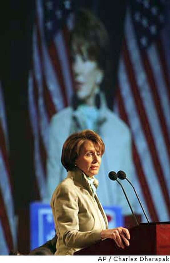 House Minority Leader Nancy Pelosi, D-Calif., addresses the Democratic National Committee at the party's winter meeting in Washington, Friday, Feb. 21. 2003. The Democratic National Committee held the winter meeting to discuss the 2004 presidential elections. Pelosi, one of the few speakers at the meeting who has not announced a White House bid, called on Democrats ``to expose the rhetorical gap between George Bush's lofty rhetoric and the harsh reality of his policies.'' (AP Photo/Charles Dharapak) Photo caption Photo: CHARLES DHARAPAK