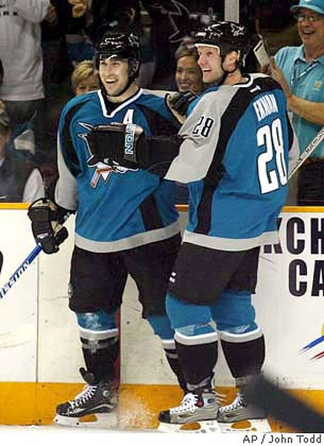 San Jose Sharks' Alan McCauley, left, is congratulated by Nils Ekman of Sweden, right, after scoring a goal during the second period in San Jose, Calif., Thursday, Jan. 24, 2004. (AP Photo/John Todd) Photo: JOHN TODD