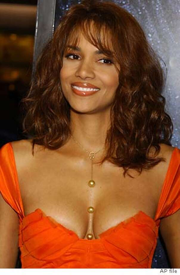 Halle Berry arrives for the World Premiere of Gothika at the Mann Village Theatre in the Westwood section of Los Angeles, Thursday, November 13, 2003. (AP Photo/Tammie Arroyo) Photo: TAMMIE ARROYO