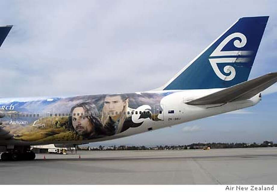 """FOR BUZZ30; Los Angeles - Leading up to the December 17 U.S. release of New Line Cinema's The Lord of the Rings: The Return of the King, Air New Zealand, """"Airline to Middle-earth,"""" unveiled the third in their fleet of The Lord of  the Rings-themed planes this week at LAX. Featuring designs inspired by the third and final film in producer/director/co-writer Peter Jackson's trilogy,  the Boeing 747-400 aircraft depicts Lake Wanaka looking towards the Matukituki Valley in New Zealand's South Island- a sweeping backdrop of tussock, lake and mountains, inset with the faces of cast members Viggo  Mortensen (Aragorn) and Orlando Bloom (Legolas.)"""