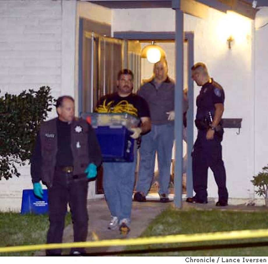 MURDER0005aa_LI.jpg  Unidentified Antioch Police detectives remove evidence from the scene of a double murder-suicide on Pear St in Antioch thursday night. By Lance Iversen/SAN FRANCISCO CHRONICLE MANDATORY CREDIT FOR PHOTOG AND SF CHRONICLE/ -MAGS OUT-WIRE SERVICES OUT Gary Fong 415-777-8428 Photo: Lance Iversen