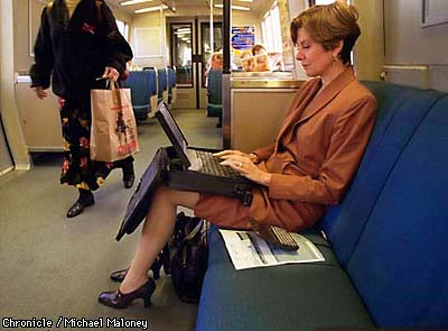 Diane DeMaio (cq) of San Ramon works on her laptop computer during her morning BART commute from Pleasanton BART station to SF where she is a senior manager in regional marketing for American Express.  During the strike, she drove to work and even spent two nights in the city to avoid the commute.  Photo by Michael Maloney Photo: MICHAEL MALONEY