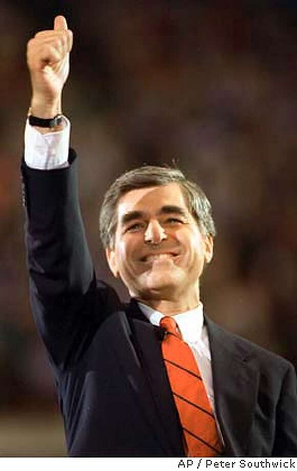 Democratic presidential candidate Michael Dukakis gives a thumbs up July 21,1988 as he arrives for his acceptance speech at the Democratic National Convention in Atlanta. (AP Photo/Peter Southwick) CAT Eugene McCarthy exceeded expectations in 1968. Photo: PETER SOUTHWICK