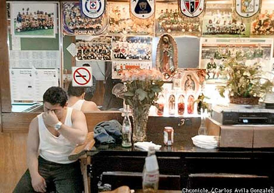 Mexico Soccer fan, Alberto De Jesus, just holds his head in El Farolito Bar in San Francisco's Mission District after time ran out in the U.S. v. Mexico World Cup game on Sunday, night, June 16, 2002. The U.S. beat Mexico, 2-0. El Farolito Bar is a haven for Soccer fanatics, sporting even a shrine complete with Virgin of Guadalupe statues as shown here. (CARLOS AVILA GONZALEZ/SAN FRANCISCO CHRONICLE) Photo: CARLOS AVILA GONZALEZ