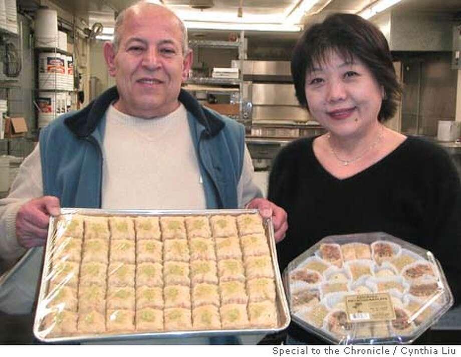 / for: Friday slug: PNOASIS;  Wadah Bahnasy holds a tray of baklava and Nobuko Bahnasy holds a pastry sampler. Cynthia Liu / HO Photo: Cynthia Liu
