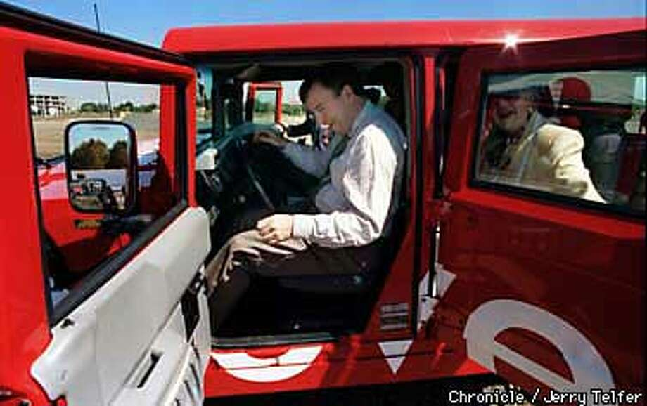 NOVELL 1/C/11SEP97/BU/JLT Novell Inc. chairman and CEO Eric Schmidt slides behind the wheel of the company Hummer after presiding over the groundbreaking ceremony for the networking firm's new San Jose, CA campus. 2126 O'Nel Drive PHOTO BY JERRY TELFER Photo: JERRY TELFER