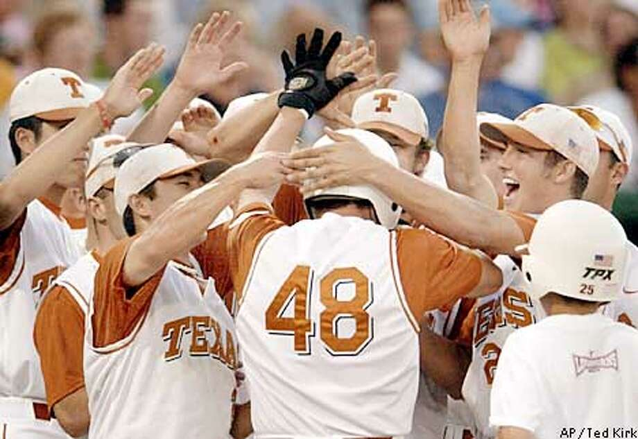 Texas' J.D. Reininger (48) celebrates with teammates after he hit a two-run home run in the fourth inning against Stanford in a College World Series game in Omaha, Neb., Monday, June 17, 2002. (AP Photo/Ted Kirk) Photo: TED KIRK