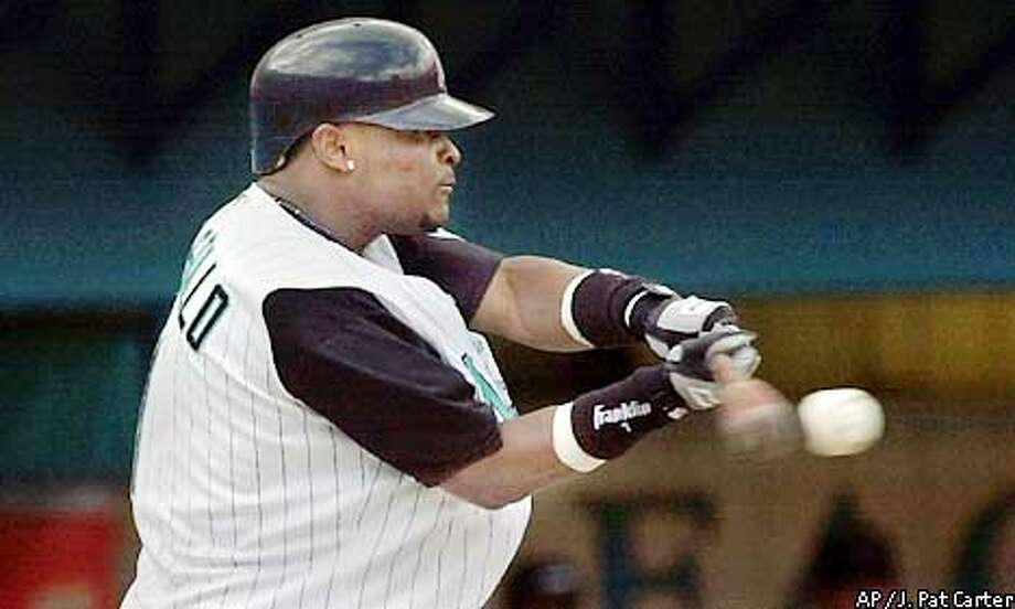 Florida Marlins batter Luis Castillo hits a first inning single to continue his hitting streak to 31 games Sunday, June 16, 2002 against the Tampa Bay Devil Rays in Miami. (AP Photo/J. Pat Carter) Photo: J. PAT CARTER