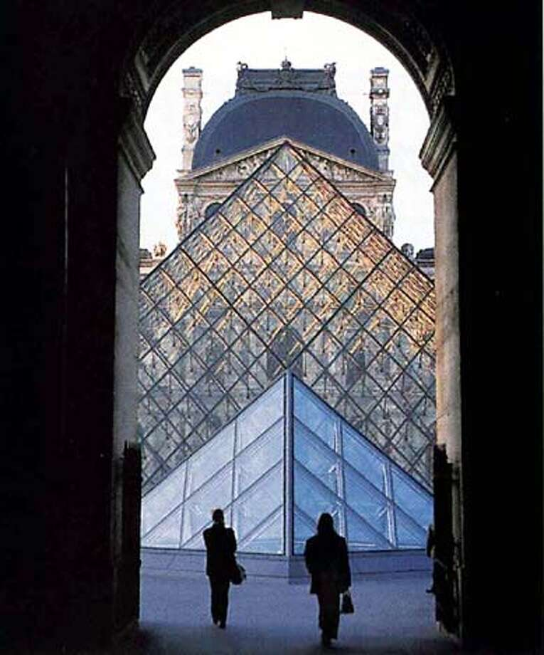 TRAVEL PARIS - I.M. Pei's pyramid at The Louvre.  SHNS photo Pyramid scheme: Visitors have been converging to count glass panes in I.M. Pei's addition to the Louvre, where a murder sets off the popular thriller's latter-day quest for the Holy Grail. A subterranean pyramid is another key to the mystery.