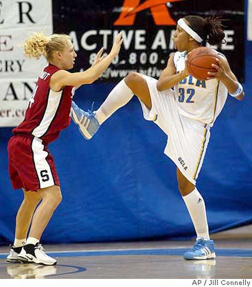 UCLA's Nikki Blue looks for an opening as Stanford's Susan King Borchardt defends during the first half Friday, Jan. 23, 2004, in Los Angeles. (AP Photo/Jill Connelly) Photo: JILL CONNELLY