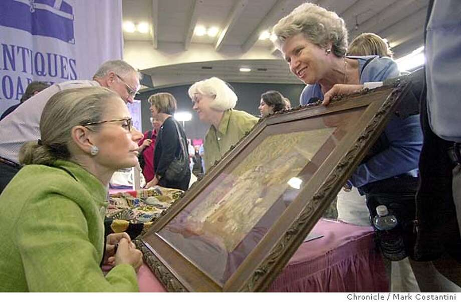 roadshow_0084.JPG  Appraiser Nancy Druckmen(left) looks over a piece of artwork as its owner looks on.  Antiques Roadshow at Moscone Center. Event of 8/16//03 in San Francsico. MARK COSTANTINI / The Chronicle Photo: MARK COSTANTINI