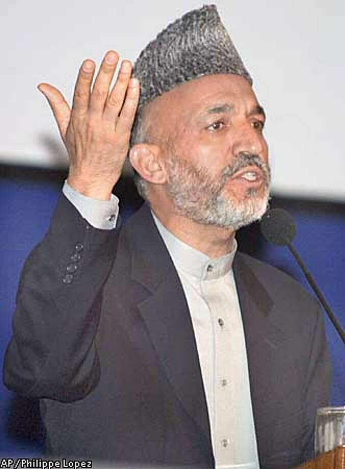 Afghan leader Hamid Karzai addresses delegates at the loya jirga, or grand assembly, in Kabul, Afghanistan Monday, June 17, 2002. (AP Photo/Philippe Lopez, Pool) Photo: PHILIPPE LOPEZ