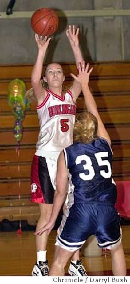 Allison Smith (5), standout girls basketball player for Burlingame High School, takes a shot in a game against Carlmont HS. 1/14/04 in Burlingame. DARRYL BUSH / The Chronicle Photo: DARRYL BUSH