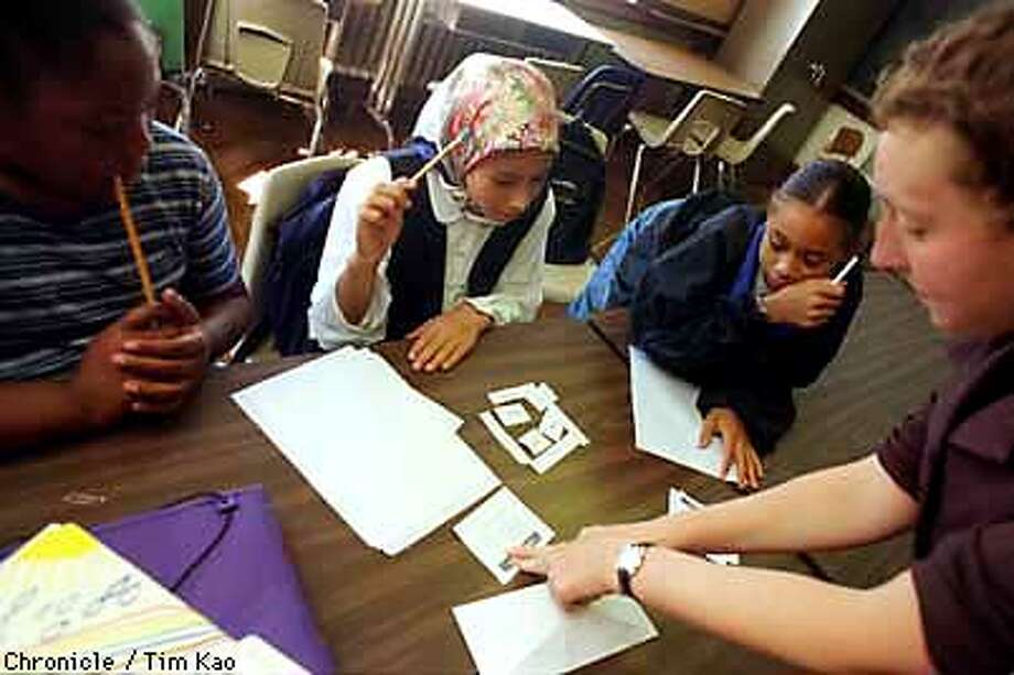 =(L-R) Rose Hunt, 10, Mona Saber, 11, and Monet Turner try to put a imaginary neighborhood together with the help of 6th grade teacher Elaine Lewinneck. PHOTO BY TIM KAO/THE CHRONICLE Photo: TIM KAO