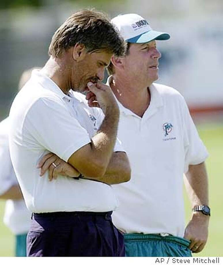 Miami Dolphins Head CoachDave Wannstedt,left and Norv Turner Assistant Head Coach/Offensive Coordinator talk after morning practice at the Miami Dolphins training camp in Davie, Fla , onTuesday, Aug.12, 2003. (AP Photo/Steve Mitchell) Photo: STEVE MITCHELL