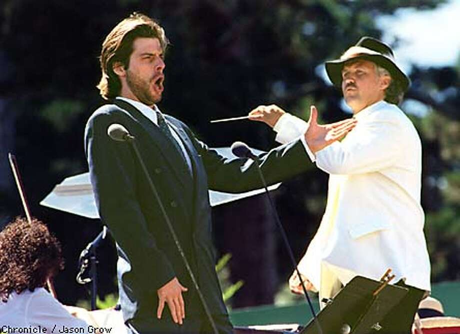 """PARK OPERA1/C/07SEPT97/MN/JG John Relyea performs """"Le Veau d'Or from Charles Gounod's """"Faust"""" as Donald Runnicles conducts the San Francicsco Opera Orchestra at the Opera in the Park in Golden Gate Park Sunday. CHRONICLE PHOTO BY JASON M. GROW"""