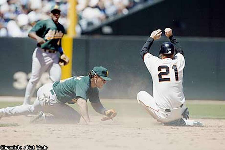 With pressure from the Oakland Atheletic's #8, Randy Velarde, The San Francisco Giant's #21 Jeff Kent steals second base off a pop up by Shawon Dunston who then made the 3rd strike out blowing a chance to over take the A's in the bottom of the 6th inning of the game at Pac Bell Park. SAN FRANCISCO CHRONICLE PHOTO BY KAT WADE Photo: KAT WADE