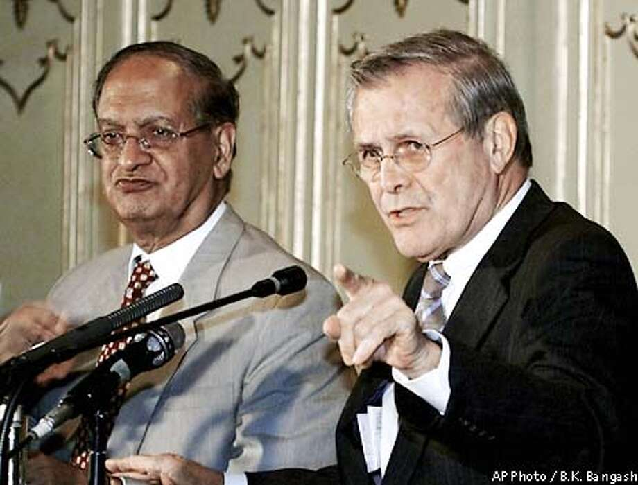 U.S. Secretary of Defense Donald H. Rumsfeld, right, speaks at a news conference at the Foreign Ministry in Islamabad, Thursday, June 13, 2002 as Pakistani Foreign Minister Abdul Sattar looks on at left. Rumsfeld shuttled from New Delhi to Islamabad in an attempt to ease the threat of war between the nuclear-armed nations. (AP Photo/B.K. Bangash) Photo: B.K. BANGASH