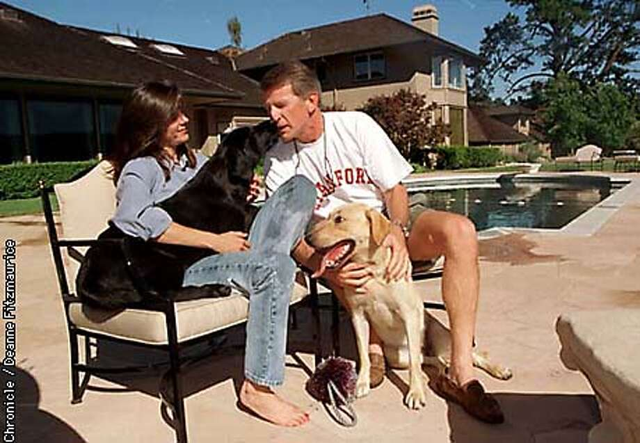 Ray Lane, second in command at Oracle Corp, relaxes at his Atherton home with his wife, Stephanie and their 2 dogs, Sandy (blond lab) and Bear (black lab). CHRONICLE PHOTO BY DEANNE FITZMAURICE