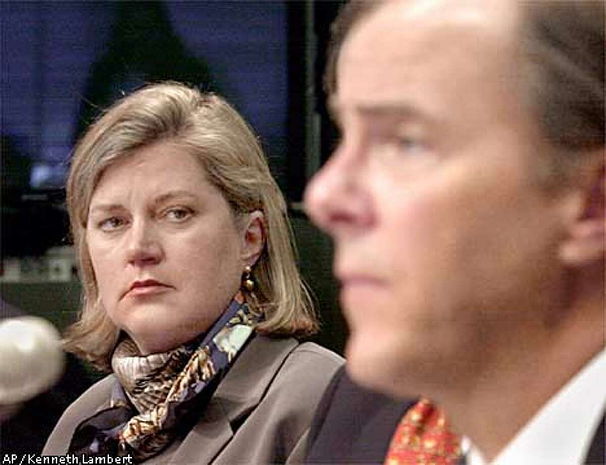 Enron Vice President for Corporate Development Sherron Watkins, left, looks on as former Enron Chief Executive Officer Jeffrey Skilling testifies on Capitol Hill Tuesday, Feb. 26, 2002 before the Senate Commerce Committee hearing on Enron. (AP Photo/Kenneth Lambert) ALSO RAN 5/17/02