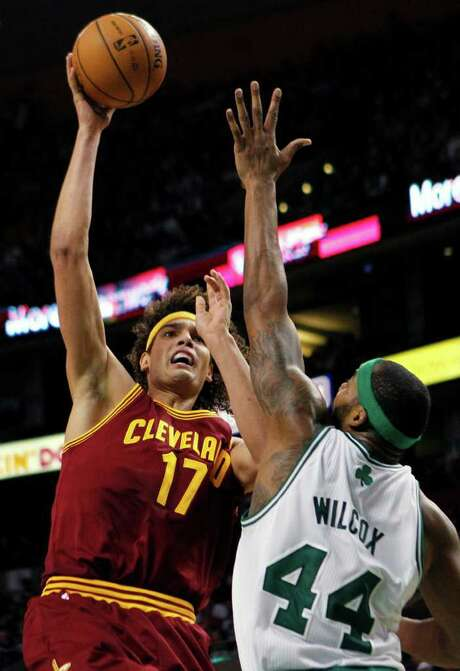 Cleveland Cavaliers' Anderson Varejao (17) shoots over Boston Celtics' Chris Wilcox (44) in the third quarter of an NBA basketball game in Boston, Sunday, Jan. 29, 2012. The Cavaliers won 88-87. Photo: AP