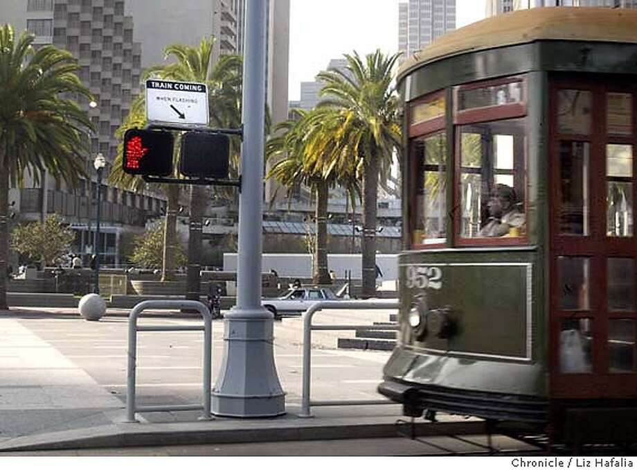 The pedestrian warning lights that signal a train is coming along the Embarcadero are not signaling properly. Shot on 1/13/04 in San Francisco. LIZ HAFALIA / The Chronicle Photo: LIZ HAFALIA