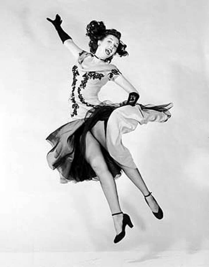 Ann Miller practices in her studio in this December 1949 photo. As a child, Miller took dancing as therapy for a case of rickets. Associated Press Photo