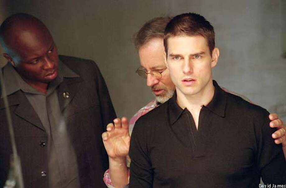 "Steven Spielberg, center, directs Tom Cruise and Steve Harris on the set of ""Minority Report."""