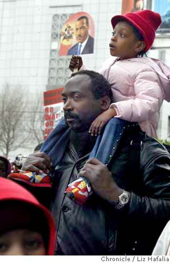 Several hundred people attended the annual Martin Luther King, Jr. Freedom March from 4th and Townsend streets to the Bill Graham Civic Auditorium. Dwight McQueen and his 4 year old daughter Shauna McQueen join the festivities at the Bill Graham Civic Auditorium. They are from Oakland. Shot on 1/19/04 in San Francisco. LIZ HAFALIA / The Chronicle Photo: LIZ HAFALIA