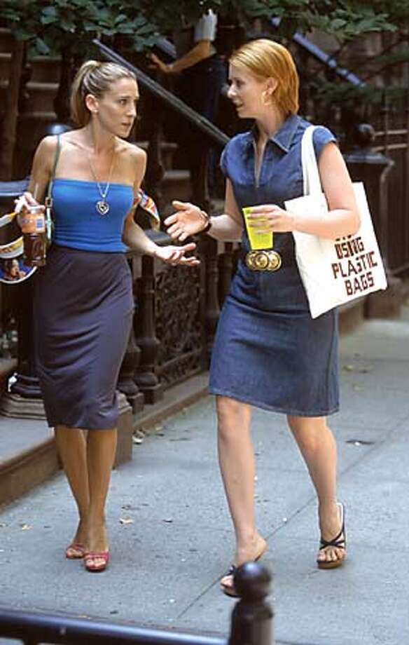 """Sarah Jessica Parker, left, and Cynthia Nixon in an episode from the third season of """"Sex and the City.''"""