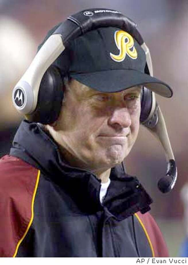 ** FILE ** Washington Redskins coach Steve Spurrier stands on the sidelines during a game against the Philadelphia Eagles at FedEx Field in Landover, Md. in this Dec. 27, 2003 file photo. For a city full of people who have to win something to get here, Washington sure has a lot of losers. Namely, the city's major professional sports teams _ the Redskins, Capitals and Wizards. But now the winningest coach in Redskins history, Joe Gibbs, is back, and the city is abuzz. (AP Photo/Evan Vucci, Files) Photo: EVAN VUCCI