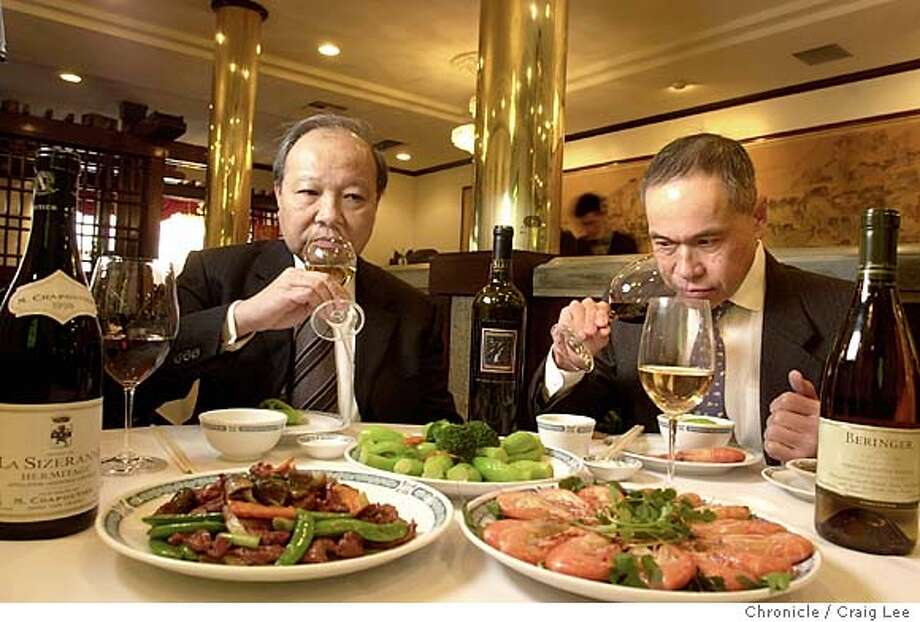 Chinese eating club that has spent ten years rooting out the best wines to go with Chinese food. Photo of Eric Leung (left) and Al Cheng (right) tasting wine with Chinese food at Great Eastern Restaurant, 649 Jackson street in Chinatown.  Event on 1/14/04 in San Francisco.  CRAIG LEE / The Chronicle Photo: CRAIG LEE