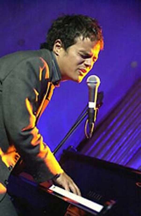 Jamie Cullum is fond of kicking, walloping and pummeling his piano