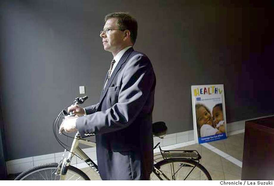 Dr. Michael van Duren, medical director of the San Francisco Health Plan - busines spotlight on the guy. He took over about nine months ago and has dived into a ton of projects. He often rides his bike from the offfice to meetings around the city he is NOT going anywhere in this photo. Posed portrait. Photo taken on 01/12/04 in San Francisco, CA. Photo By LEA SUZUKI / The San Francisco Chronicle Photo: LEA SUZUKI
