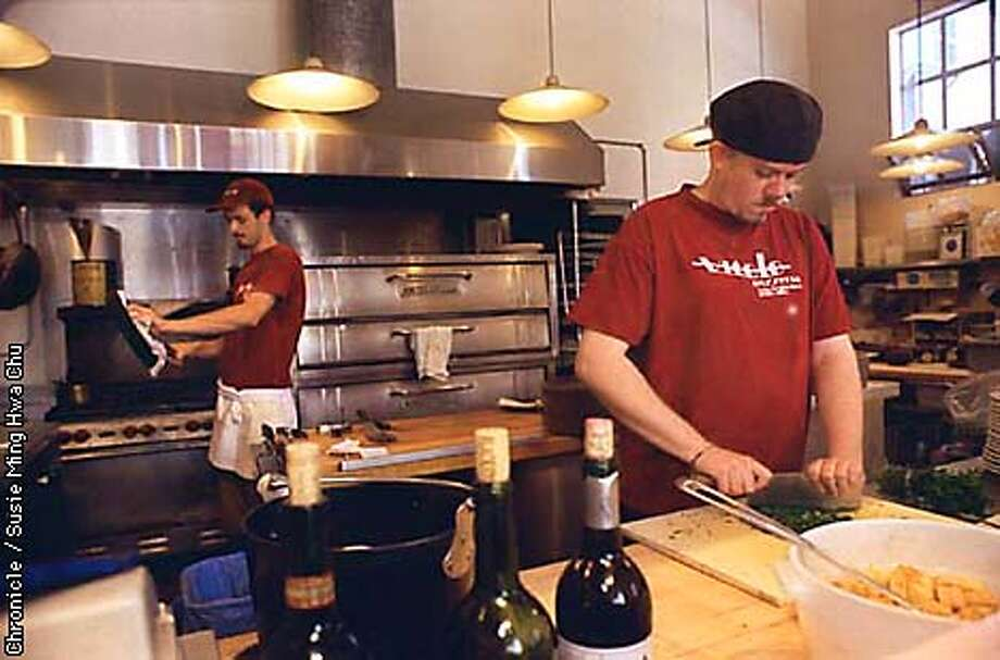 HAYESVICOLO/C/6AUG97/PK/SMHC  Chefs Kevin Hudson, right, and Bryan Dawson prepare ingredients for Pizzas at lunch. CHRONICLE PHOTO BY SUSIE MING HWA CHU.