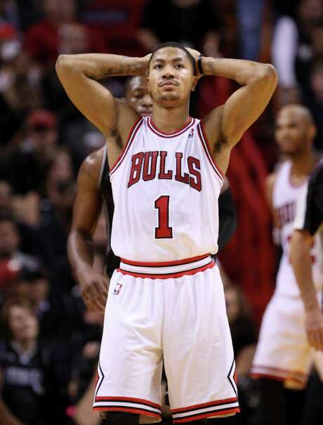 Chicago Bulls guard Derrick Rose reacts after a play during the second half of an NBA basketball game against the Miami Heat, Sunday, Jan. 29, 2012, in Miami. Rose scored 34 points for Chicago, but missed a pair of foul shots that would have given Chicago the lead with 22.7 seconds left. The Heat defeated the Bulls 97-93. Photo: AP