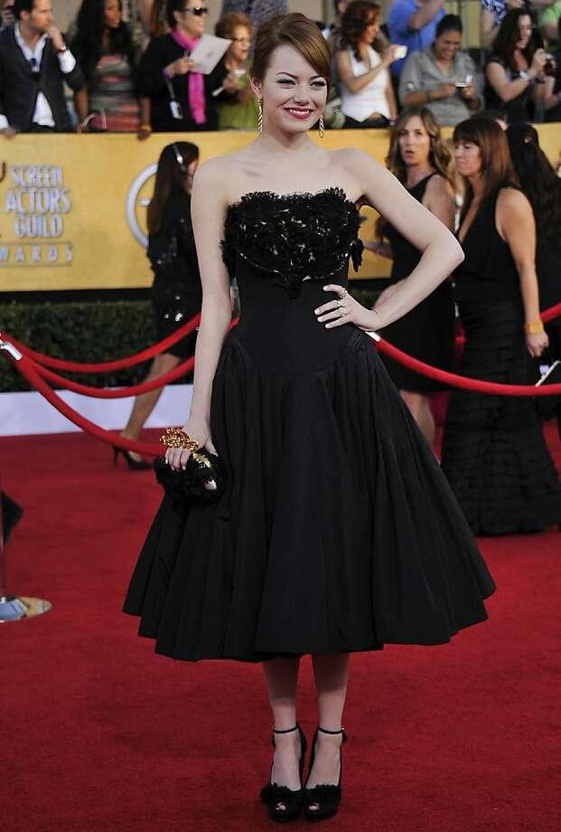 Emma Stone  arrives at the 18th Annual Screen Actors Guild Awards held at the Shrine Auditorium in Los Angeles, California on January 29, 2012. AFP PHOTO / JOE KLAMAR (Photo credit should read JOE KLAMAR/AFP/Getty Images) Photo: Joe Klamar, AFP/Getty Images