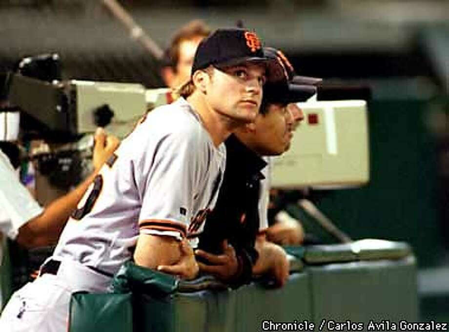 Giants' pitcher Shawn Estes watches the game action at the interleague game between the As and the Giants on Wednesday night, September 3, 1997. (CHRONICLE PHOTO BY CARLOS AVILA GONZALEZ) Photo: CARLOS AVILA GONZALEZ